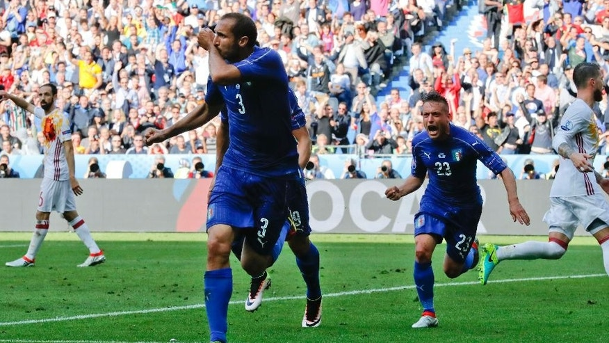 Italy's Giorgio Chiellini celebrates after scoring his side's first goal during the Euro 2016 round of 16 soccer match between Italy and Spain, at the Stade de France, in Saint-Denis, north of Paris, Monday, June 27, 2016. (AP Photo/Antonio Calanni)