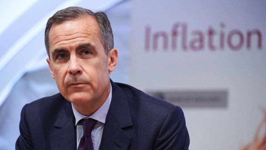 FILE - This is a Thursday, Feb. 4, 2016  file photo of Mark Carney, the Governor of the Bank of England, as he pauses, during the quarterly Inflation Report press conference, in London. Bank of England Governor Mark Carney and Fed chair Janet Yellen were due to speak on a panel Wednesday June 289, 2016 but were taken off the updated schedule released Monday June 27, 2016. (Niklas Halle'n, Pool Photo, File via AP)