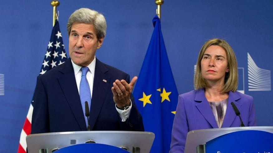U.S. Secretary of State John Kerry, left, speaks during a media conference with European Union High Representative Federica Mogherini, right, at EU headquarters in Brussels on Monday, June 27, 2016. Kerry is on a one day trip to meet with NATO and EU officials. (AP Photo/Virginia Mayo)