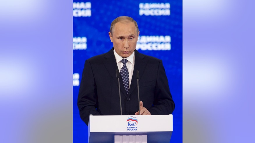Russian President Vladimir Putin addresses the audience at the United Russia party congress which is being held three months ahead of parliamentary elections, in Moscow, Russia  Monday, June 27, 2016. (AP Photo/Ivan Sekretarev, Pool)