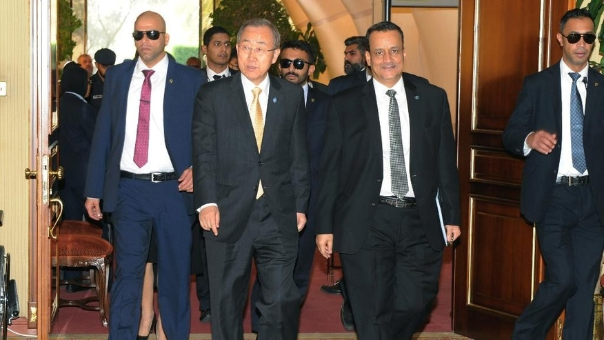 "In this Sunday, June 26, 2016 photo released by the Kuwait Ministry of Information and made available Monday, June 27, U.N. Secretary-General Ban Ki-moon, second left, arrives for the Yemeni Peace Talks with Yemeni delegations in Kuwait. Ban urged Yemen's warring factions to keep working toward a comprehensive agreement, warning that ""time is not on the side of the Yemeni people,"" in remarks Sunday to delegates taking part in peace talks that began in Kuwait two months ago. (Kuwait Ministry of Information via AP)"