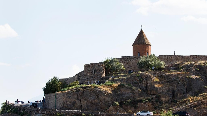 Pope Francis' car drives up carrying him to attend a ceremony at the Khor Virap's monastery near Ararat's mountain, Armenia, Sunday, June 26, 2016. Francis wrapped up his trip with calls for closer ties with Armenia's Oriental Orthodox church and a joint declaration with the Apostolic Church leader on the plight of Christians in the Mideast. (AP Photo/Alexander Zemlianichenko)