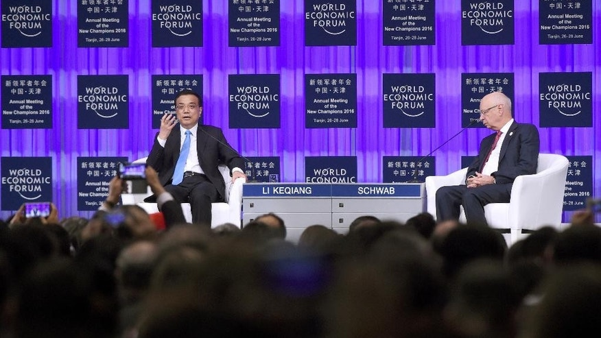 Chinese Premier Li Keqiang, left, answers a question as founder and Executive Chairman of the World Economic Forum Klaus Schwab listens during the World Economic Forum in Tianjin, China Monday, June 27, 2016. (Wang Zhao/Pool Photo via AP)