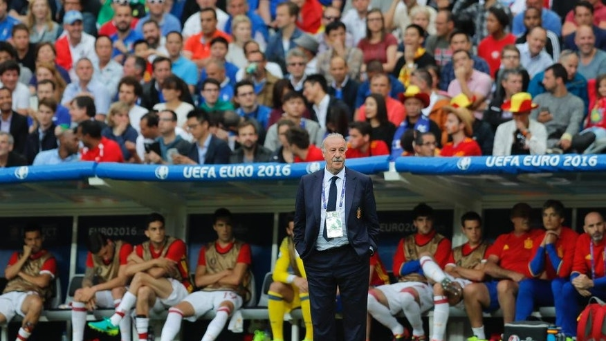 Spain coach Vicente del Bosque stands in front of the bench during the Euro 2016 round of 16 soccer match between Italy and Spain, at the Stade de France, in Saint-Denis, north of Paris, Monday, June 27, 2016. (AP Photo/Manu Fernandez)