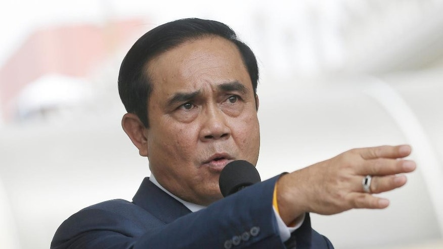 In this June 6, 2016 photo, Thailand's Prime Minister Prayuth Chan-ocha answer question from reporters at Government house in Bangkok, Thailand. The head of Thailand's military government said Monday, June 27, 2016, that he will not step down if an August referendum fails to approve a draft constitution it is promoting. (AP Photo/Sakchai Lalit)