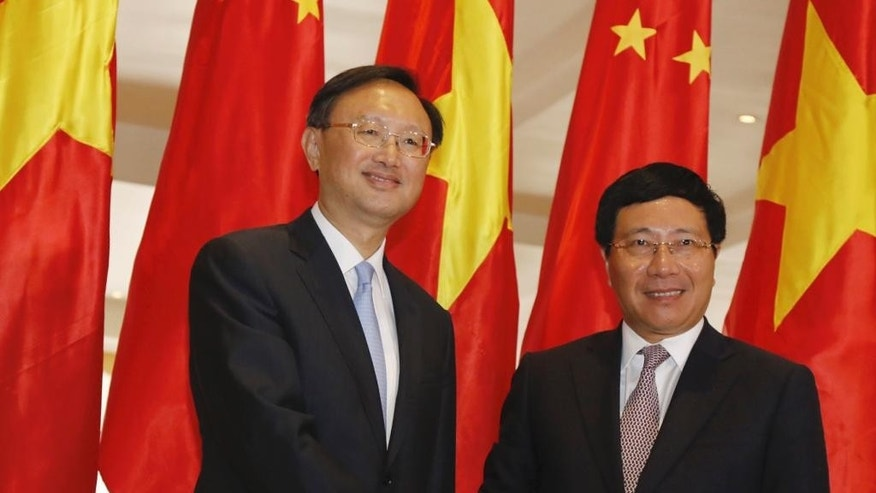 Chinese State Councilor Yang Jiechi, left, shakes hands with Vietnamese Foreign Minister Pham Binh Minh at the start of a bilateral conference in Hanoi, Vietnam Monday, June 27, 2016. Yang is on a two-day visit to Vietnam to try to promote cooperation amid growing tension over Chinese growing assertiveness in the South China Sea. (AP Photo/Tran Van Minh)
