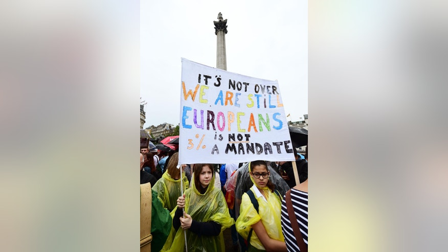 Supporters hold a banner during a pro-EU rally in Trafalgar Square in London, after some of the pro-EU events organized in the aftermath of last week's historic referendum have been cancelled at short notice over safety concerns, Tuesday, June 28, 2016. (Ian West/PA via AP) UNITED KINGDOM OUT