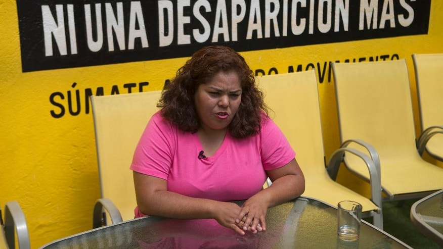 Claudia Medina Tavariz talks during an interview, at the Amnesty International office in Mexico City, Monday, June 27, 2016. Blindfolded and handcuffed, Medina was arrested in August 2012 and believes she was taken to a local Navy base where her captors accused her of working with organized crime. Over a period of hours she was beaten, sexually assaulted, jolted with electric shocks and subjected to simulated drowning. Human rights defender Amnesty International says Medina's experience is common among women arrested in Mexico. (AP Photo/Eduardo Verdugo)
