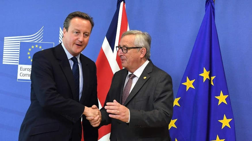 European Commission President Jean-Claude Juncker, right, greets British Prime Minister David Cameron prior to a meeting at EU headquarters in Brussels on Tuesday, June 28, 2016. EU heads of state and government meet Tuesday and Wednesday in Brussels for the first time since Britain voted to leave the European Union, throwing British and European politics into disarray. (AP Photo/Geert Vanden Wijngaert)