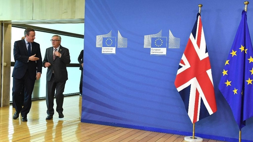 European Commission President Jean-Claude Juncker, right, walks with British Prime Minister David Cameron prior to a meeting at EU headquarters in Brussels on Tuesday, June 28, 2016. EU heads of state and government meet Tuesday and Wednesday in Brussels for the first time since Britain voted to leave the European Union, throwing British and European politics into disarray. (AP Photo/Geert Vanden Wijngaert)