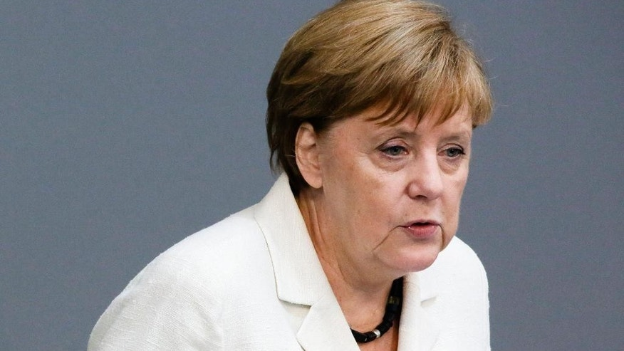 German Chancellor Angela Merkel addresses the German parliament Bundestag with a so-called Government Declaration about the British vote to leave the EU, in Berlin, Tuesday, June 28, 2016. (AP Photo/Markus Schreiber)