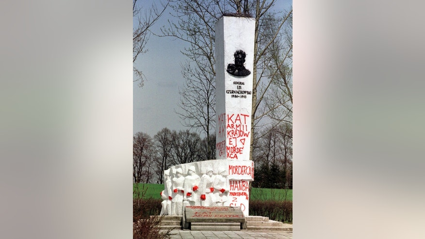 "FILE - In this April 30, 2001 file photo taken in Pieniezno, Poland, graffiti with insults like ""Murderer"" and ""Shame"" can be seen on a memorial to Soviet General Ivan Chernyakhovsky, who is considered a symbol of the imposition of communism in Poland, but a national hero in Russia. Polish authorities are planning to move more than 200 communist-era monuments to Soviet troops into a former Red Army base to testify to a historic ""untruth."" Pawel Ukielski, deputy head of the state Institute of National Remembrance, or IPN, said that the plan covers structures put up in the 1940s and '50s to glorify the Red Army's march through Poland at the end of World War II as it was defeating the Nazi Germans.(AP Photo/Wojtek Jakubowski, File) POLAND OUT"