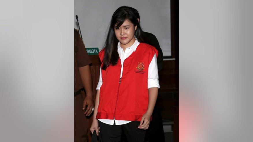 Jessica Kumala Wongso who is accused of murdering her friend by poisoning her with cyanide enters the courtroom prior to the start of her trial hearing at Central Jakarta District Court in Jakarta, Indonesia, Tuesday, June, 28, 2016.  An Indonesian court has decided to proceed with the trial of the woman.  The 27-year-old defendant,  Wongso was charged with planning the Jan. 6 poisoning of Wayan Mirna Salihin because of the victim's advice that she sever her relationship with her troublesome boyfriend. The two were former classmates in Australia.(AP Photo/Tatan Syuflana)