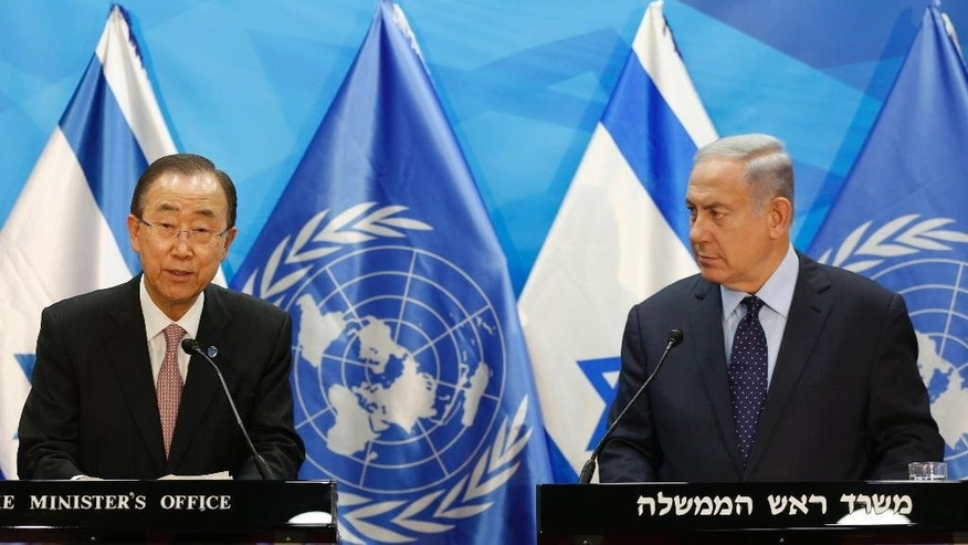 Israeli Prime Minister Benjamin Netanyahu, right, looks at UN Secretary General Ban Ki-moon during a joint press conference in Jerusalem, Tuesday, June 28, 2016. (Ronen Zvulun/Pool Photo via AP)