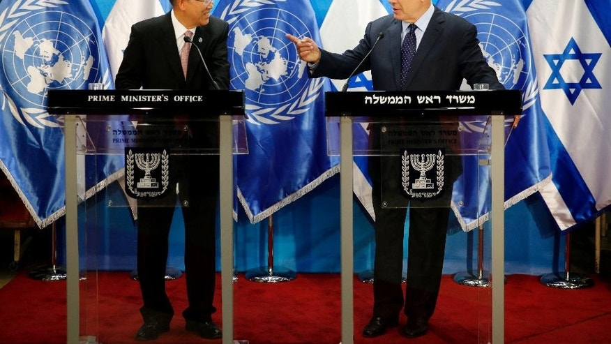 Israeli Prime Minister Benjamin Netanyahu, right, speaks with UN Secretary General Ban Ki-moon during a joint press conference in Jerusalem, Tuesday, June 28, 2016. (Ronen Zvulun/Pool Photo via AP)