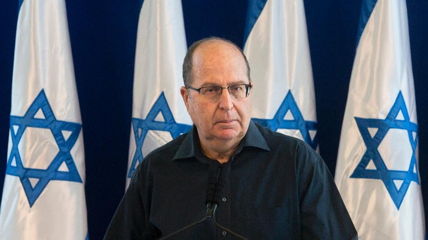 "File - In this Friday, May 20, 2016 file photo, Israel's Defense Minister Moshe Yaalon, speaks during a press conference at the Defense Ministry in Tel Aviv, Israel. Israel's defense minister announced his resignation on Friday, citing a lack of ""trust"" in Prime Minister Benjamin Netanyahu after reports in recent days that he is soon to be replaced. Israel's long-serving Benjamin Netanyahu faces a potentially formidable challenge to his hardline rule _ not from civilian politicians but instead from the country's revered security establishment. (AP Photo/Sebastian Scheiner, File)"