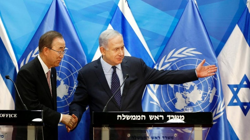 Israeli Prime Minister Benjamin Netanyahu, right, gestures to UN Secretary General Ban Ki-moon after a joint press conference in Jerusalem, Tuesday, June 28, 2016. (Ronen Zvulun/Pool Photo via AP)