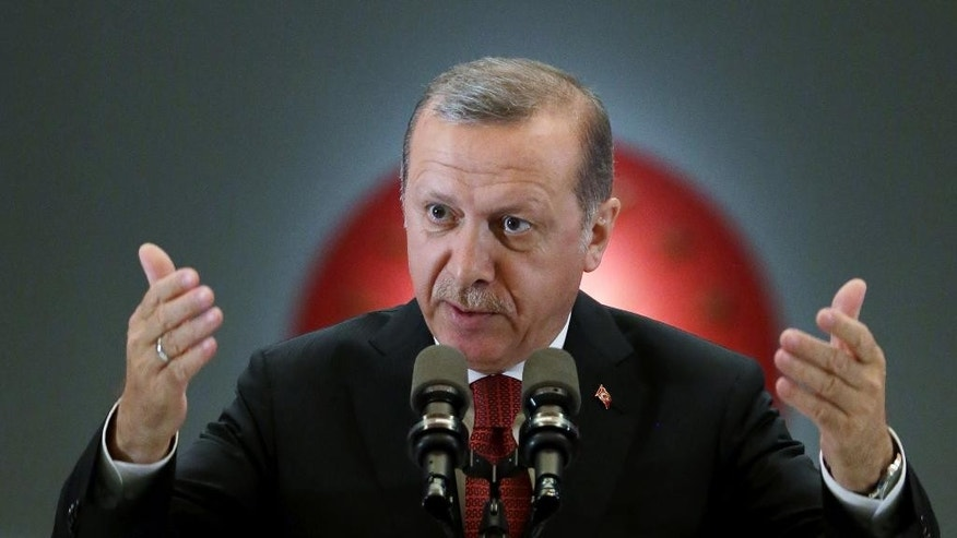 "Turkey's President Recep Tayyip Erdogan addresses people gathered for a traditional ""Iftar"" feast at his palace in Ankara, Turkey, Monday, June 27, 2016. Erdogan has apologized to Russia, expressing his ""sympathy and deep condolences"" to the family of the killed pilot for the downing of a Russian military jet at the Syrian border, Dmitry Peskov spokesman for Russian President Vladimir Putin said on Monday.   (Murat Cetinmuhurdar, Presidential Press Service, Pool via AP)"