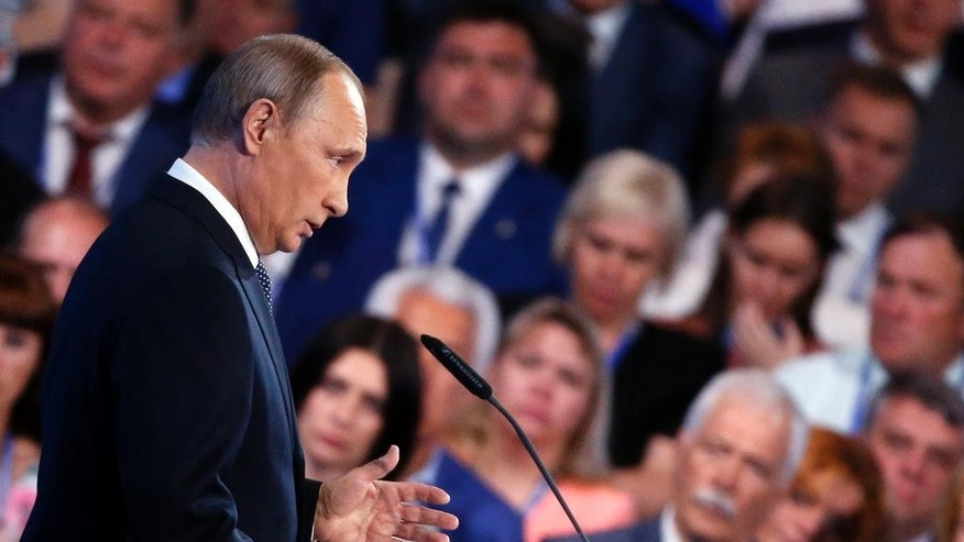 Russian President Vladimir Putin addresses the audience at the United Russia party congress which is being held three months ahead of parliamentary elections, in Moscow, Russia, on Monday, June 27, 2016. (Maxim Shipenkov/Pool photo via AP)