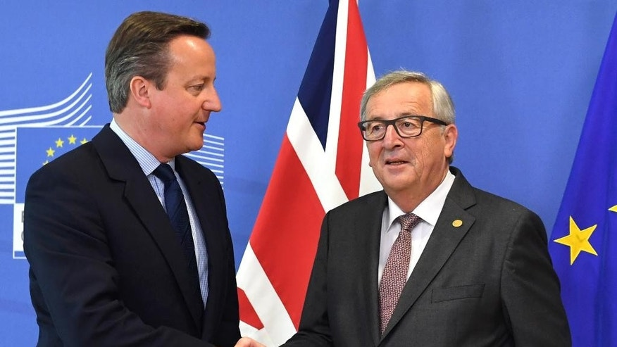 European Commission President Jean-Claude Juncker, right, shakes hands with British Prime Minister David Cameron prior to a meeting at EU headquarters in Brussels on Tuesday, June 28, 2016. EU heads of state and government meet Tuesday and Wednesday in Brussels for the first time since Britain voted to leave the European Union, throwing British and European politics into disarray. (AP Photo/Geert Vanden Wijngaert)