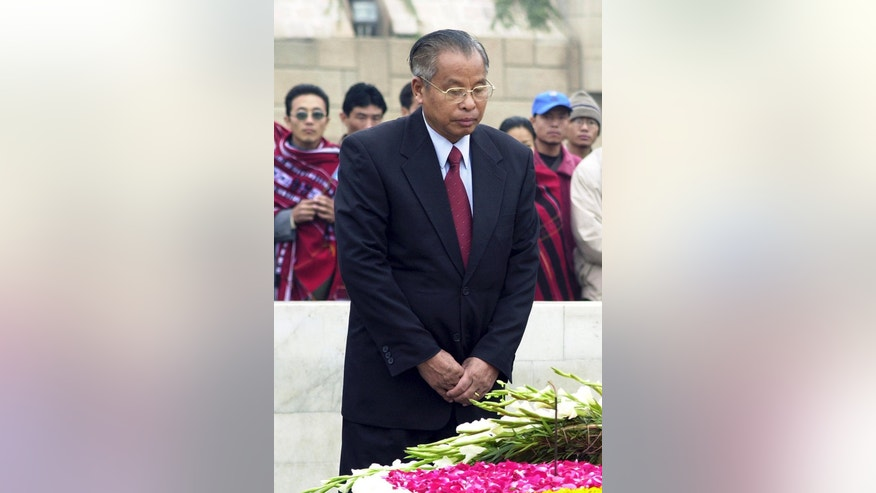 FILE-In this Jan. 9, 2003 file photo, Naga rebel leader Isak Chishi Swu, pays homage at the Mahatma Gandhi Memorial in New Delhi, India. Swu who led a bloody insurgency in India's northeast for over three decades, died Tuesday, June 28, 2016 following multi-organ failure at a New Delhi hospital, the Press Trust of India reported. (AP Photo/Ajit Kumar)