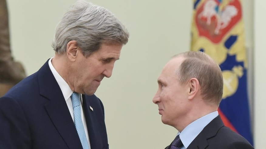 Secretary of State John Kerry, left, with Russian President Vladimir Putin in December.
