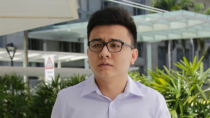 "Yang Kaiheng, 27, co-founder of ""The Real Singapore"" website, arrives at the State Court on Tuesday, June 28, 2016, in Singapore. Yang has pleaded guilty to six counts of sedition for provoking hatred of foreigners in the city-state by publishing accounts of obnoxious visitors. (AP Photo/Wong Maye-E)"