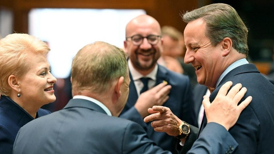 British Prime Minister David Cameron, right, speaks with Danish Prime Minister Lars Lokke Rasmussen, second left, and Lithuanian President Dalia Grybauskaite, left, during a round table meeting at an EU summit in Brussels on Tuesday, June 28, 2016. EU heads of state and government meet Tuesday and Wednesday in Brussels for the first time since Britain voted to leave the European Union, throwing British and European politics into disarray. (AP Photo/Geert Vanden Wijngaert)