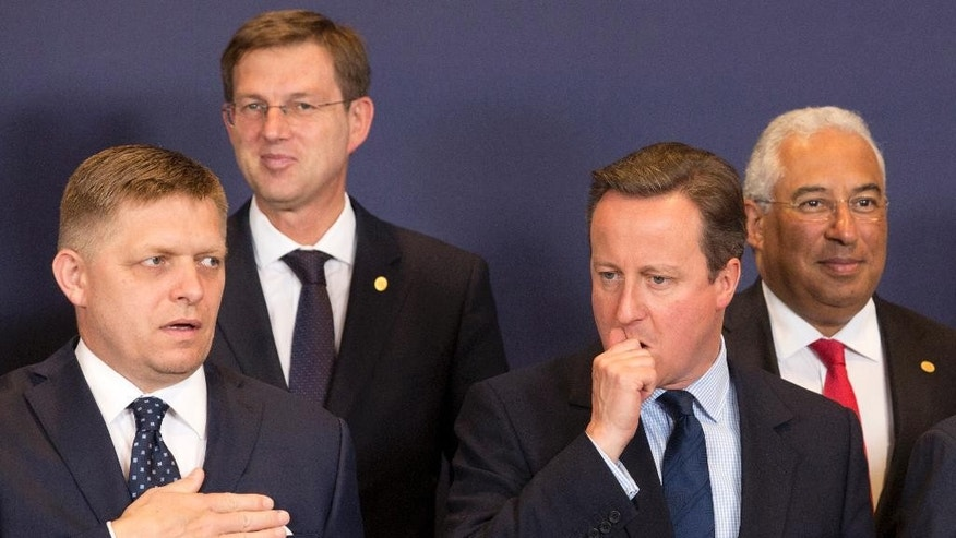 British Prime Minister David Cameron, second right, waits for the start of a group photo at an EU summit in Brussels on Tuesday, June 28, 2016. EU heads of state and government meet Tuesday and Wednesday in Brussels for the first time since Britain voted to leave the European Union, throwing British and European politics into disarray. At left is Slovenian Prime Minister Miro Cerar and right is Portuguese Prime Minister Antonio Costa. (AP Photo/Geoffroy Van der Hasselt)