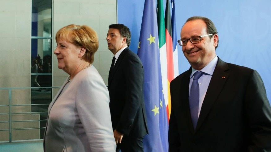 German Chancellor Angela Merkel, left, the Prime Minister of Italy Matteo Renzi, centre, and the President of France Francois Hollande, right, leave a news conference during a meeting at the chancellery in Berlin, Monday, June 27, 2016.  The three leaders said they agreed there will be no formal or informal talks, until the British government formally declares its intention to quit the EU. (AP Photo/Markus Schreiber)