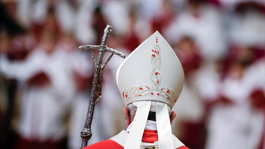 Pope Francis arrives to celebrate a Mass where he bestowed the Pallium, a woolen shawl symbolizing the bond to the pope, to 25 new Archbishops in St. Peter's Basilica at the Vatican, Wednesday, June 29, 2016. (AP Photo/Gregorio Borgia)