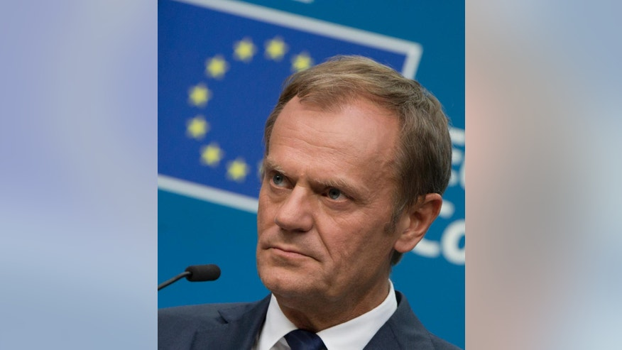 European Council President Donald Tusk listens to questions during a media conference at an EU summit in Brussels on Tuesday, June 28, 2016. European Union leaders began plotting a future without Britain on Tuesday, urging the island nation and economic powerhouse to disentangle itself as fast as possible from the other 27 nations in the bloc to avoid extending the turmoil that has been roiling European and global markets. (AP Photo/Virginia Mayo)