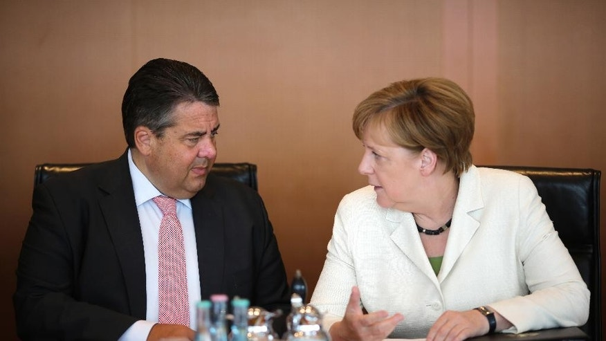 German Chancellor Angela Merkel, right, talks with Vice Chancellor and Economy Minister Sigmar Gabriel prior to the cabinet meeting of the German government at the chancellery in Berlin, Tuesday, June 28, 2016. (AP Photo/Markus Schreiber)