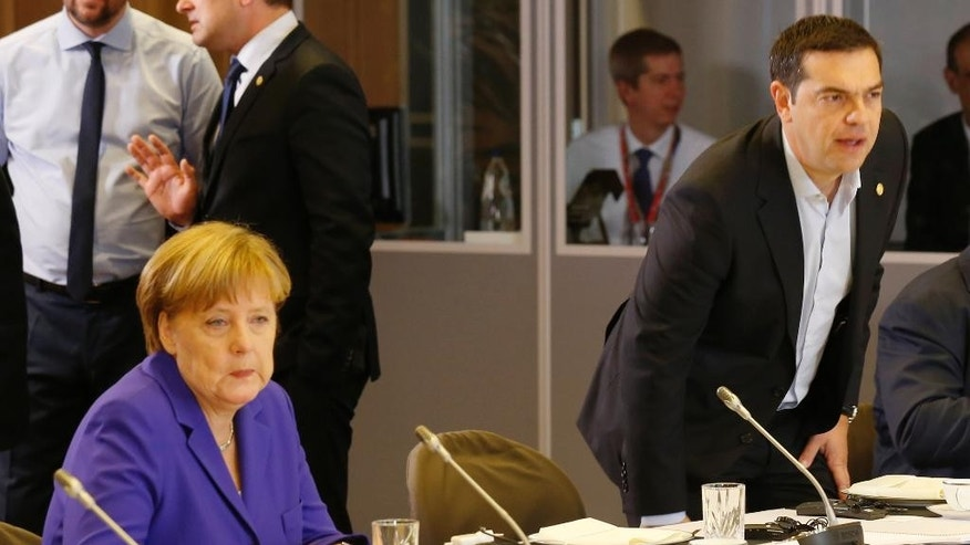German Chancellor Angela Merkel, left, and Greek Prime Minister Alexis Tsipras attend a round table meeting at an EU summit in Brussels on Wednesday, June 29, 2016. European Union leaders are meeting without Britain for the first time since the British referendum to rethink their bloc and keep it from disintegrating after Britain's unprecedented vote to leave. (Pascal Rossignol, Pool Photo via AP)