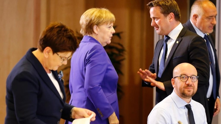 German Chancellor Angela Merkel, second left, speaks with Luxembourg's Prime Minister Xavier Bettel, second right, during a round table meeting at an EU summit in Brussels on Wednesday, June 29, 2016. European Union leaders are meeting without Britain for the first time since the British referendum to rethink their bloc and keep it from disintegrating after Britain's unprecedented vote to leave. (Pascal Rossignol, Pool Photo via AP)