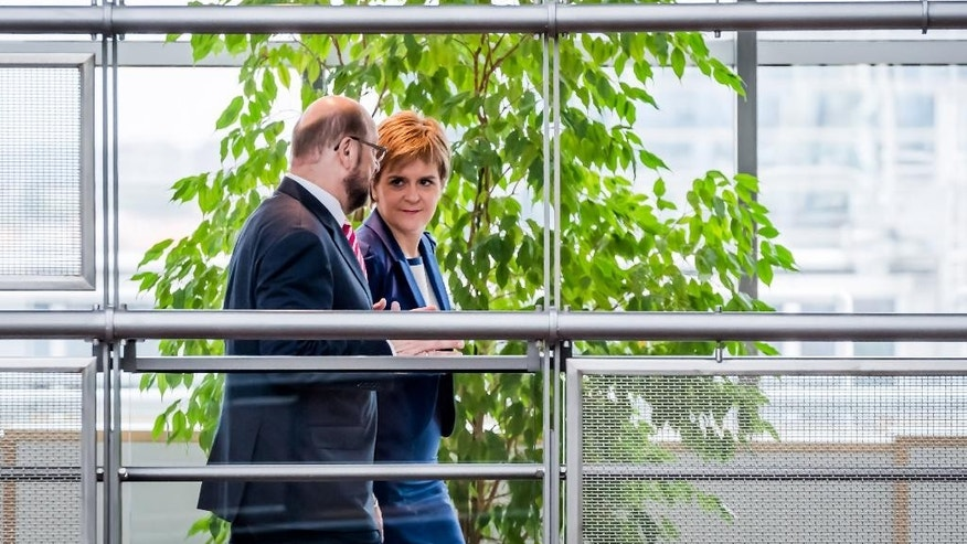 European Parliament President Martin Schultz, left, walks with Scottish First Minister Nicola Sturgeon at the European Parliament in Brussels on Wednesday, June 29, 2016. Sturgeon is in Brussels to meet with European Parliament fraction leaders. (AP Photo/Geert Vanden Wijngaert)
