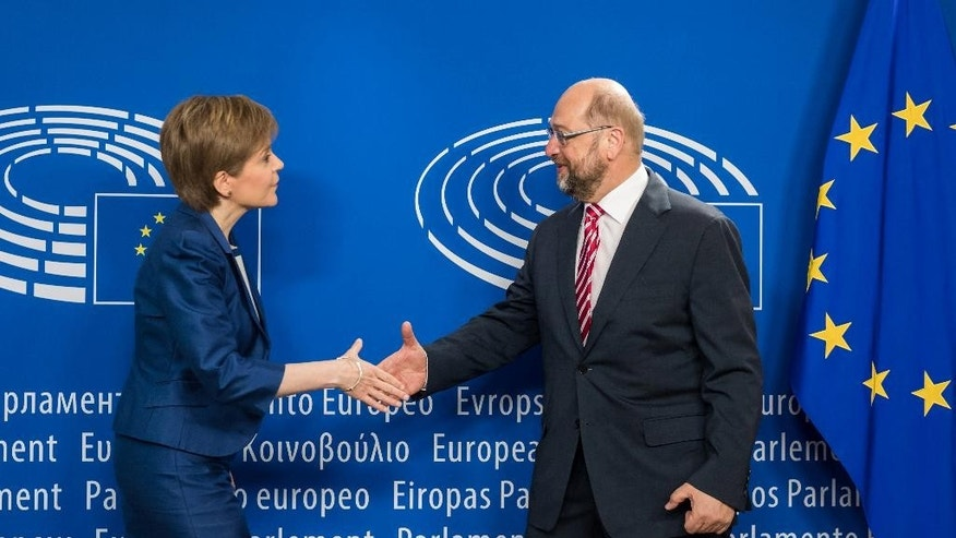 European Parliament President Martin Schultz, right, greets Scottish First Minister Nicola Sturgeon at the European Parliament in Brussels on Wednesday, June 29, 2016. Sturgeon is in Brussels to meet with European Parliament fraction leaders. (AP Photo/Geert Vanden Wijngaert)