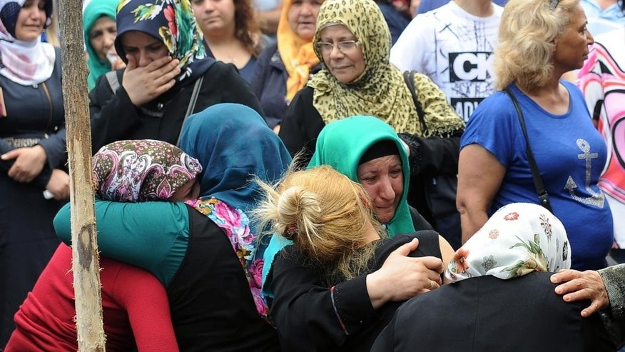 Family members of victims cry outside Bakirkoy State Hospital in Istanbul, Wednesday, June 29, 2016. Suicide attackers killed dozens and wounded more than 140 at Istanbul's busy Ataturk Airport late Tuesday, the latest in a series of bombings to strike Turkey in recent months. Turkish officials said the massacre was most likely the work of the Islamic State group. Turkish authorities have banned distribution of images relating to the Ataturk airport attack within Turkey.(AP Photo/Omer Kuscu) TURKEY OUT