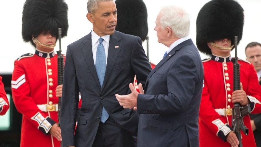 President Barack Obama talks with Governor General of Canada David Johnston on the tarmac upon his arrival on Air Force One at Ottawa Macdonald-Cartier International Airport in Ottawa, Canada, Wednesday, June 29, 2016. Obama traveled to Ottawa for the North America Leaders' Summit with Canadian Prime Minister Justin Trudeau and Mexican President Enrique Pena Neito. (AP Photo/Pablo Martinez Monsivais)