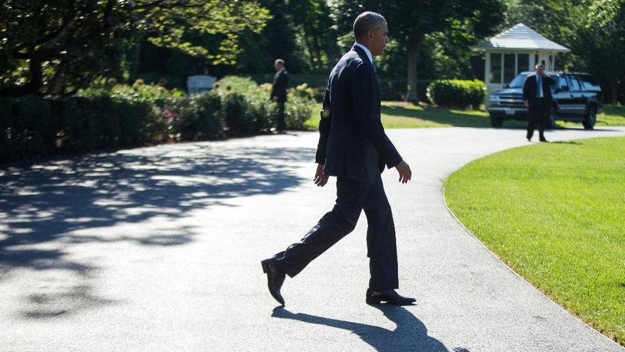President Barack Obama walks on the South Lawn of the White House in Washington, Wednesday, June 29, 2016, to board Marine One for a short trip to Andrews Air Force Base, Md., than onto Ottawa, Canada. (AP Photo/Evan Vucci)