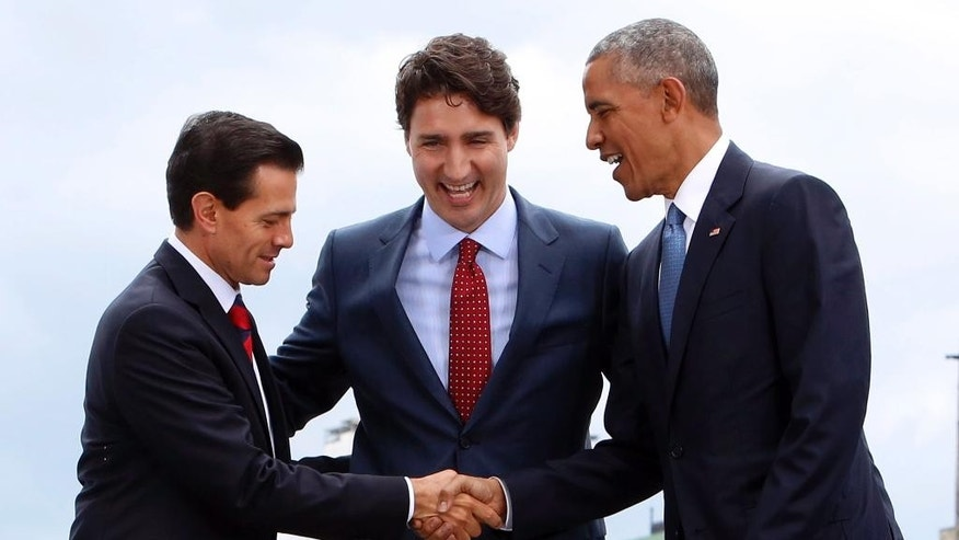 Mexico President Enrique Pena Nieto, left, Canada Prime Minister Justin Trudeau, center, and President Barack Obama pose for a photo at the North American Leaders Summit at the National Gallery of Canada in Ottawa, Wednesday, June 29, 2016. (Fred Chartrand/The Canadian Press via AP) MANDATORY CREDIT