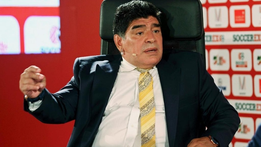 FILE - In this May 4, 2015, file photo, Argentina football legend Diego Maradona speaks on the second day of the SoccerEx Asian Forum conference in Southern Shuneh, Jordan. Maradona urged fellow Argentines on Wednesday, June 29, 2016, to leave Lionel Messi alone over the current star's decision to retire from Argentina's national team following its loss to Chile in the Copa America championship match. (AP Photo/Raad Adayleh, File)