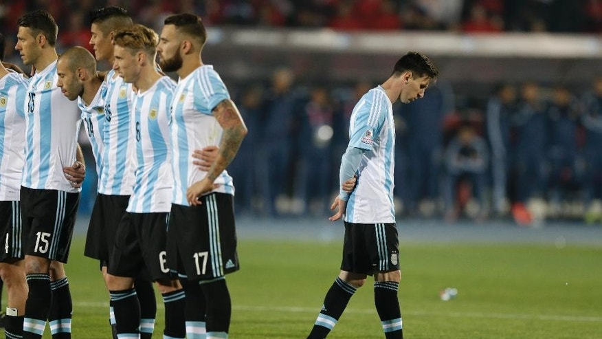 FILE - In this July 4, 2015 file photo, Argentina's Lionel Messi, right, reacts after Argentina's Gonzalo Higuain, missed his penalty kick against Chile during the Copa America final soccer match at the National Stadium in Santiago, Chile. Messi's shocking decision to stop playing for Argentina could further hurt his already tarnished legacy with his national team. If Messi sticks to his announcement, made in the heat-of-the-moment shortly after Argentina's penalty shootout loss to Chile in Sunday's Copa America final on June 26, 2016, Argentina will be left dwelling on the fact that it was not able to win any significant title while having one of the best players of all time.  (AP Photo/Ricardo Mazalan, File)