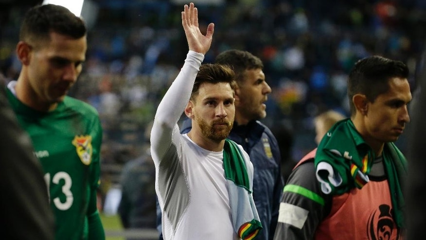 FILE - In this June 14, 2016 file photo, Argentina's Lionel Messi waves to fans at the end of a Copa America Centenario Group D soccer match against Bolivia, in Seattle. Messi's shocking decision to stop playing for Argentina could further hurt his already tarnished legacy with his national team. If Messi sticks to his announcement, made in the heat-of-the-moment shortly after Argentina's penalty shootout loss to Chile in Sunday's Copa America final on June 26, 2016, Argentina will be left dwelling on the fact that it was not able to win any significant title while having one of the best players of all time.  (AP Photo/Elaine Thompson, File)