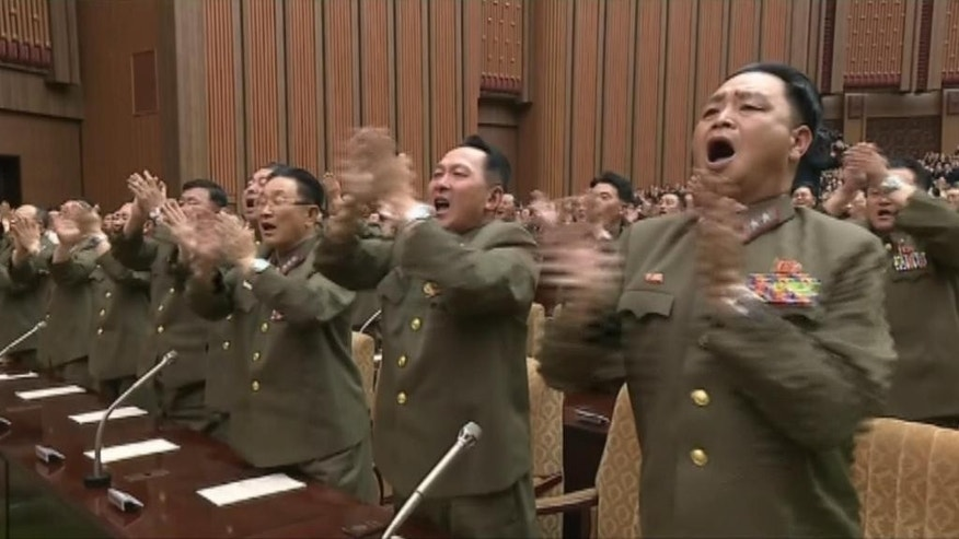 Military officers cheer during North Korea's Supreme People's Assembly, chaired by their leader Kim Jong Un, convened Wednesday June 29, 2016, in Pyongyang, North Korea.  Kim Jong Un vowed to continue developing nuclear weapons while also strengthening the country's economy. (NKO via AP Photo)