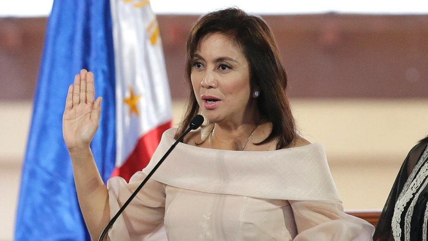 """Philippine Vice President Leni Robredo is sworn in during inauguration ceremonies in suburban Quezon city, north of Manila, Philippines on Thursday June 30, 2016. Robredo won over Sen. Ferdinand """"Bongbong"""" Marcos Jr., the son of the late strongman Ferdinand Marcos, in a closely-contested race on May 9 which also resulted in the presidential victory of Rodrigo Duterte, who will be separately sworn in Thursday at the Malacanang presidential palace. (AP Photo/Aaron Favila)"""