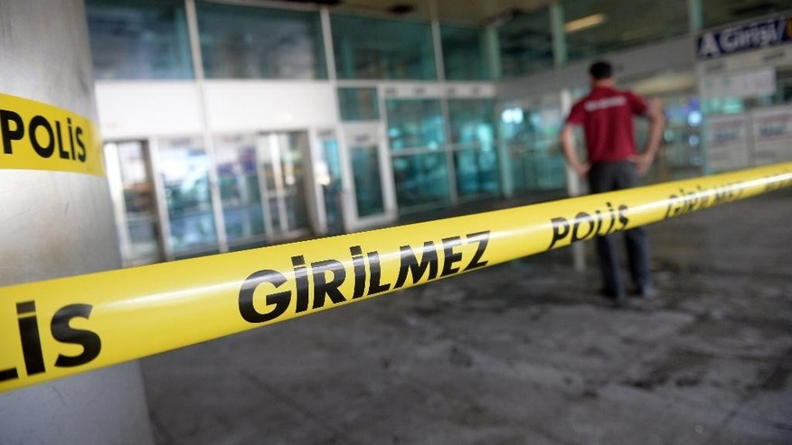 A worker inspects the damages at the entrance of Istanbul's Ataturk airport, Wednessday, June 29, 2016. Suicide attackers killed dozens at the busy airport late Tuesday, the latest in a series of bombings to strike Turkey in recent months. Turkish officials said the massacre was most likely the work of the Islamic State group. (AP Photo) TURKEY OUT