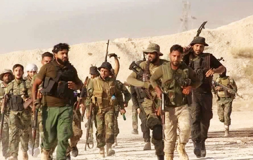 This photo released on Tuesday June 28, 2016, provided by the New Syrian Army anti-government rebels, which has been authenticated based on its contents and other AP reporting, shows U.S.-backed Syrian rebels of the New Syrian Army run in an unknown place in Syria. Islamic State militants on Wednesday pushed back U.S.-trained Syrian rebels from the outskirts of a town on the Iraqi border, dealing a setback to a budding offensive that aims to sever the militants' transit link between Syria and Iraq, a rebel spokesman said. (The New Syrian Army via AP)