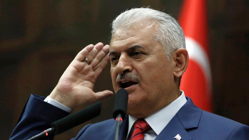 Turkey's Prime Minister Binali Yildirim addresses lawmakers at the parliament a day after he announced the details of an agreement reached with Israel, in Ankara, Turkey, Tuesday.