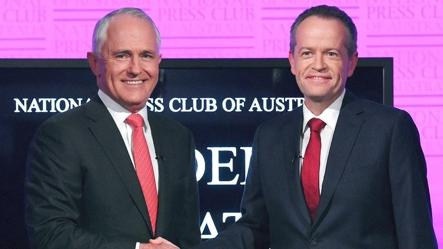 FILE - In this May, 29, 2016, file photo, Australia's Prime Minister Malcolm Turnbull, left, and opposition leader Bill Shorten shake hands as they arrive for a debate in Canberra. Australians go to the polls Saturday, July 2, 2016, with the opposition leader vying to become the country's fifth prime minister in three years. (Tracey Nearmy/Pool Photo via AP, File)